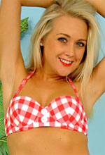 Pin Up Wow - Sexy petite blonde in a bikini teases with fruit